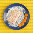 Carrot and coconut cake on yellow surface — Stock Photo