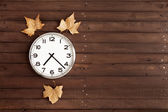 Clock with three leaves — Stock Photo