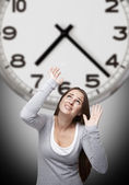 Clock and woman with grey background — Stock Photo