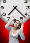 Clock and woman with red background — Stock Photo
