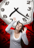 Time pressure on a woman with red background — Stock Photo