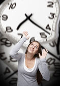 Time pressure on a woman with grey background — Stock Photo