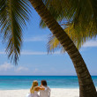 Loving couple on a tropical beach — Stock Photo