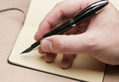 Writing with fountain pen — Stock Photo