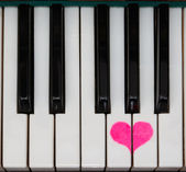 Piano keyboard love — Stock Photo