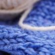 Blue yarn with a needle — Stock Photo
