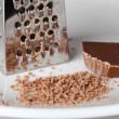 Chocolate grater and crumbs — Stock Photo