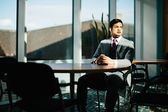Businessman sitting at a desk — Stock Photo
