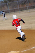 Little league baseball player running bases — Stock Photo