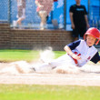 Little league baseball player sliding home. — Stock Photo