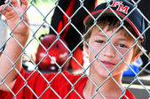 Youth baseball player in dugout — Stock Photo