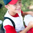Little league baseball player happy after game. - Stock Photo