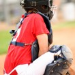 Stock Photo: Catcher in red jersey