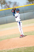 Little league pitcher starting his wind up. — Stock Photo