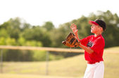 Little league baseball player catching the ball. — Stock Photo