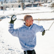 Bald boy throwing snowball — Stock Photo
