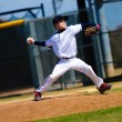 Stock Photo: Little league pitcher in white jersey