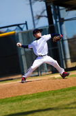 Little league pitcher in white jersey — Stock Photo