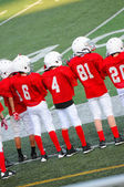 Young football players on sidelines — Foto Stock