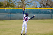 Youth outfielder catching ball — Stock Photo