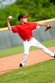 Youth ball player throwing ball — Stock Photo