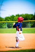 Baseball player running bases — Stock Photo