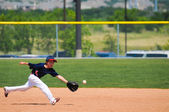 Little league boy reach out to catch ball — Stock Photo