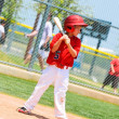 Youth baseball player with wood bat. - Stock Photo