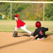 Little league player getting an out — Stock Photo #22814754