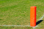 Orange football pylon — Stockfoto