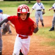 Stock Photo: Little league baseball player running bases