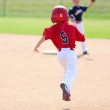 Baseball player running to second base — Stock Photo