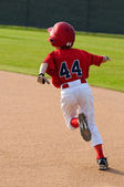 Baseball boy running bases — Stock Photo