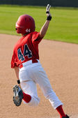 Little league player running bases. — Stock Photo