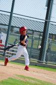 Little league player swinging bat — Stock Photo