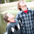 Two young boys looking up — Stock Photo