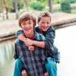 Two young boys piggy back — Stock Photo