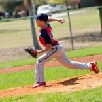 Постер, плакат: Teen baseball pitcher