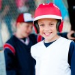 Little league baseball boy in dugout — Stock Photo