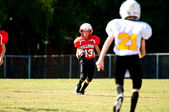 Youth running back football player — Stock Photo