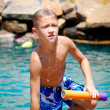 Boy getting out of swimming pool — Stock Photo #27731651