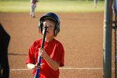 Baseball boy staring at bat — Stock Photo