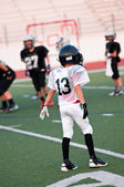 Young american football player — Stock Photo