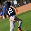 Teen baseball player running home — Stock Photo #30245395