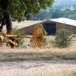 Farm equipment with barn in background — Stock Photo #31970063