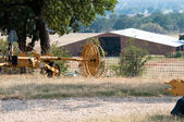 Farm equipment with barn in background — Stock Photo