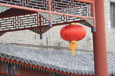 Red lantern with historic building — Stock Photo