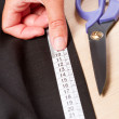 Stock Photo: Fabric measuring
