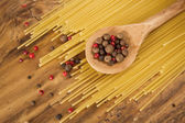Spaghetti and spoon with spice — Stock Photo