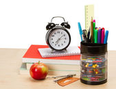 School supplies and alarm clock — Stock Photo